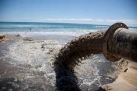 marine-pollution-sewage-pipe-draining-in-ocean-in-la